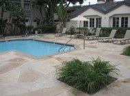 Outdoor concrete topping pool deck resurfaced with Sunstamp